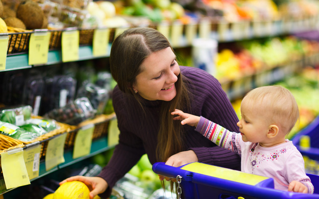Woman buying vegan food with child