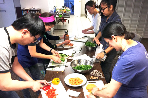 Vegan Batch Cooking Club - Everybody at work in a community kitchen