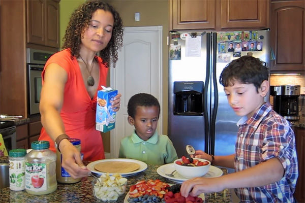 Dr Yami vegan pediatrician in the kitchen with her kids in a 2014 Youtube video