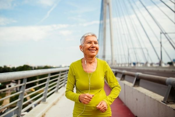 nutrition for plant-based runners interview with Kayla Slater (photo of older woman running)
