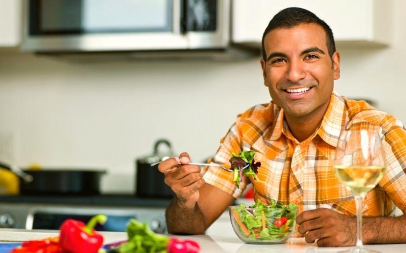 Wife is going vegan - Man eating salad